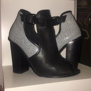 Black and white ankle booties with cutouts